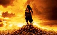 аватары: мужчина с мечем на черепах стоит