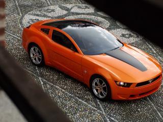 обои Оранжевый мустанг сверху фото