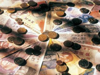 обои Купюры и монеты, сложенные в форме круга фото