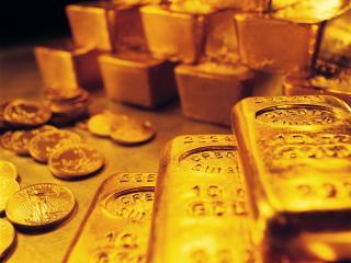 обои Мягкий, жёлтый блеск золотых монет и слитков фото