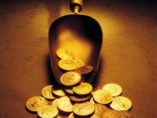 обои Золотой совок - орудие банкира - и россыпь золота фото