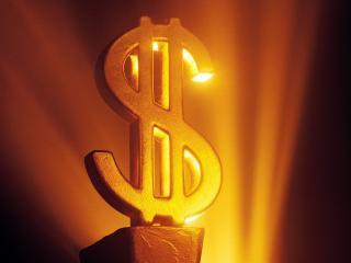 обои Золотая статуя доллара в свете прожектора фото