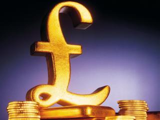 обои Золотое изображение английского фунта на возвышении фото