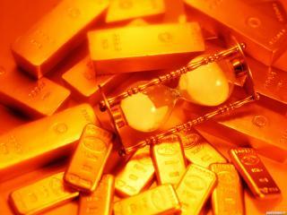 обои Золотые слитки и песочные часы фото