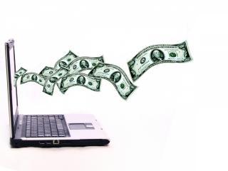 обои Деньги из ноутбука фото