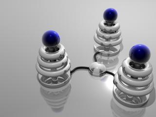 обои Три конические пирамидки, увенчанные шариками силы фото