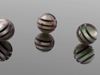 обои Три рифлёных шарика на зеркальном столе фото