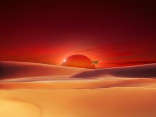 обои Багровый восход над бесплодными песками пустыни фото