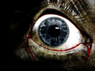 обои Истекающий кровью глаз зомби фото