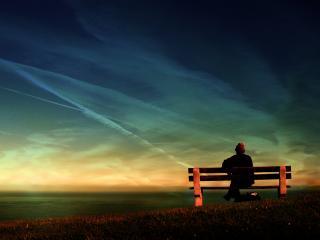 обои Человек сидиящий на скамейке фото