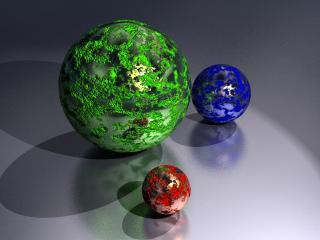 обои Три шара разной величены и цвета фото
