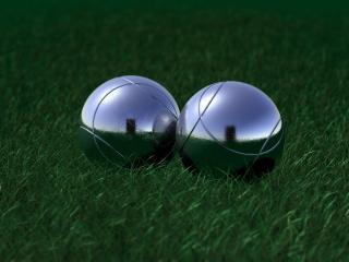 обои Два металлических шара на траве фото