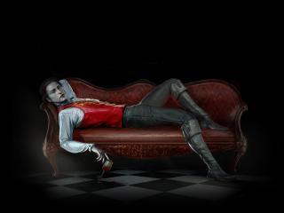 обои Вампир на кожанном диване фото