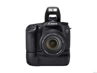обои Фотоаппарат Canon с зуммом и вспышкой на подставке фото