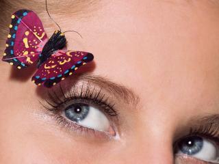 обои Девушка с украшением бабочки фото