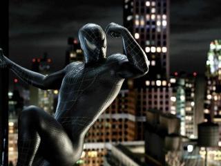 обои Чёрный человек-паук на небоскрёбе фото