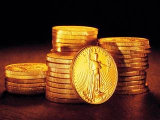обои Стопки золотых монет фото