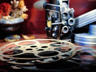 обои Бобина киноленты на фоне Кинокамеры фото