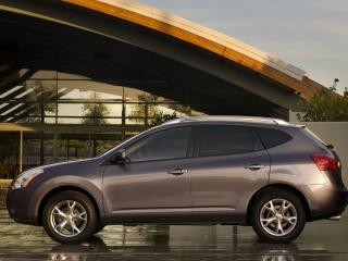 обои Nissan Rogue 2010 на против дома сбоку фото