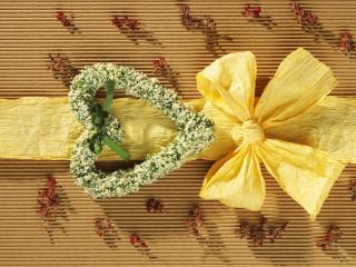 обои Желтый бантик с сочетанием цветочного сердца фото
