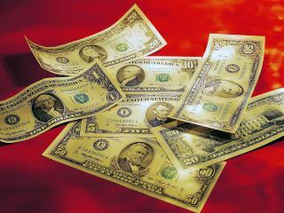 обои Доллары на красном фоне фото