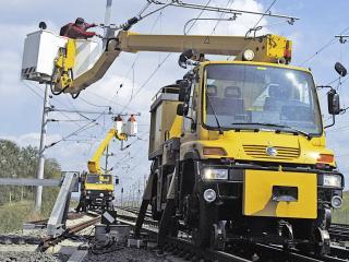 обои Mercedes-Benz Unimog обслуживание железнодорожных сетей фото