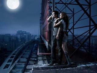 обои Влюблённые любуются ночным городом фото