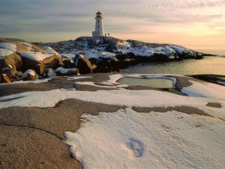 обои Маяк на снежном острове фото