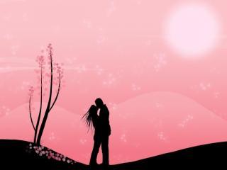 обои Влюблённая пара на фоне розового неба фото