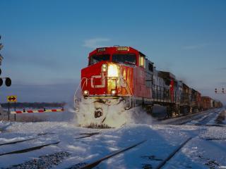 обои Поезд мчица сквозь снег фото
