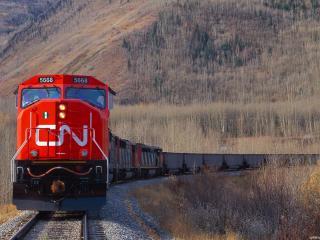 обои Длинный красный поезд фото