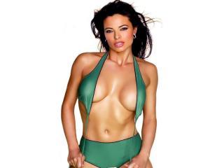 обои Natalia Estrada в зелёном купальнике фото