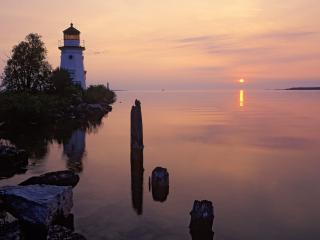 обои Cheboygan Range Light Silhouetted at Sunrise,  Cheboygan,  Michigan фото