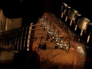 обои Гитара и ее струны фото