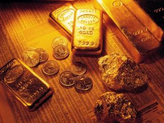 обои Слитки и монеты из золота фото