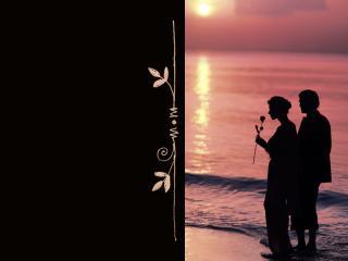 обои Влюблённые вечером у моря фото