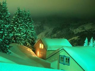 обои Деревянные домики в заснеженных горах фото