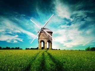обои Мельница посреди зеленого поля фото