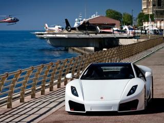 обои Красивая машина на берегу моря фото