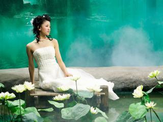 обои Азиатка с лотусами фото