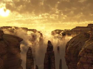 обои Высокие каменные статуи в облаках фото