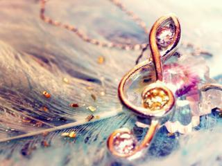 обои Скрипичный ключ золотое украшение фото