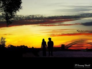 обои Двое любуются закатом фото