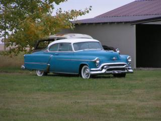 обои 1953 oldsmobile coupe parked фото