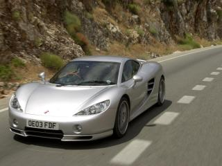 обои Ascari kz1 driving on road фото