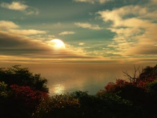обои Вечернее солнце в облаках над морем фото