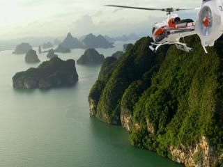 обои Вертолет над морем фото