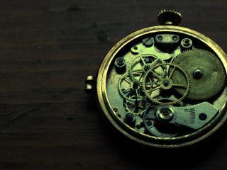 обои Механизм часов шестеренки фото
