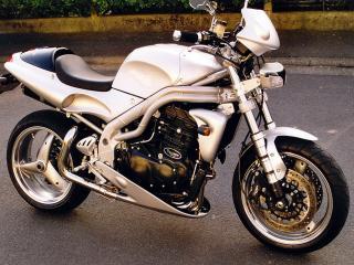 обои Серебристый мотоцикл Триумф фото