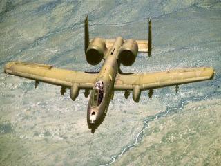 обои Самолет ведет разведку местности фото